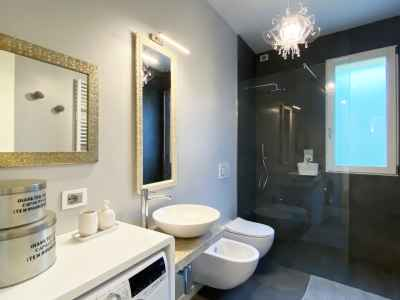 bathroom with toilet, bidet, sink and shower